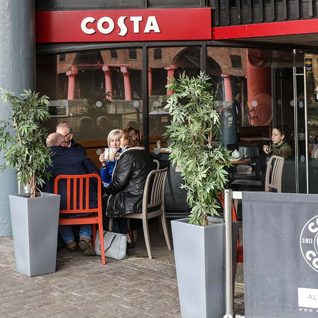 Customers drinking coffee at Costa Coffee