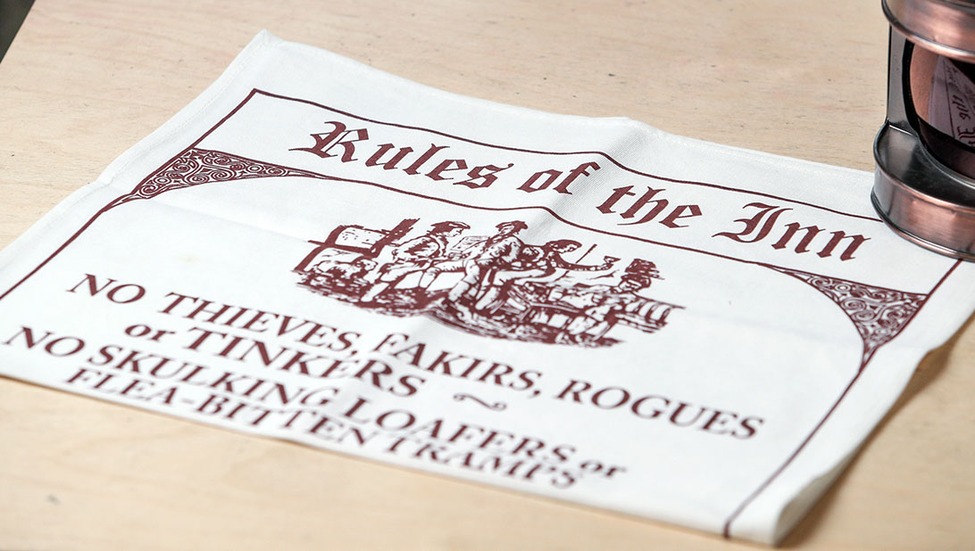 Rules of the Inn tea towel