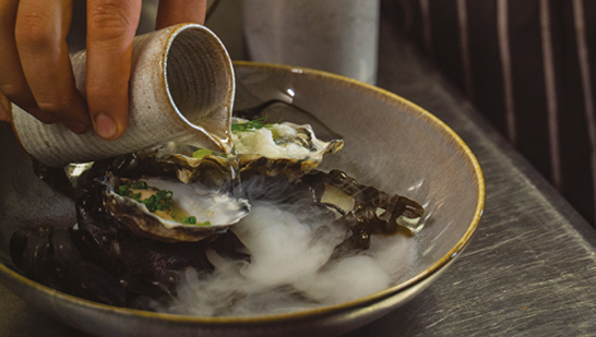 Oysters in a smoking bowl